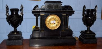 Large Victorian black slate and metal mounted mantel clock, having black Roman numerals to a