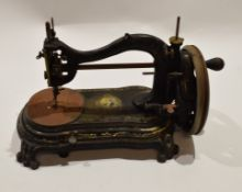 Late 19th century black cast metal sewing machine, indistinct trademark with the head and