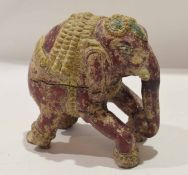 An unusual Tang style model of an elephant carved in wood with traces of original colouring, 16cm