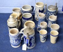 Collection of German Westerwald type stoneware tankards, most with German mottos and typical