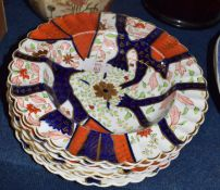 Group of mid-19th century Copeland plates and two bowls, all decorated with a Japan style pattern,