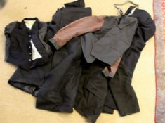 Box of used work clothing, some railway, including jackets and trousers.
