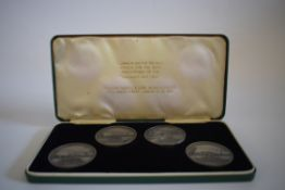 Set of 4 commemorative medalions, in green presentation case, struck for the 50th anniversary of the