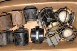 A box of eleven non-railway lamps, some electric, variable condition.