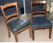Pair of sturdy wooden railway interest GER office chairs, one with worn green Rexine pad, the