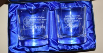 Pair of hand cut lead crystal glasses, engraved 'Anglia Railways Charter Mark Winner 1993 & 1996, in