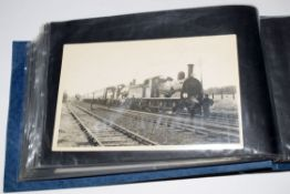Blue photo album 23 x 14cm containing approx 45 purchased railway-interest postcard size b/w
