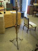Attractive early C20th Art Nouveau style tall metal Lamp Stand, raised on three scrollwork feet with
