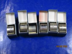 Collection of six boxed hallmarked silver Napkin Rings