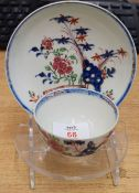 18th century Lowestoft porcelain tea bowl and saucer decorated with a polychrome design in