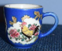 18th century Chinese porcelain cup, the gros bleu ground with vignettes of a chicken and a dog