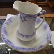 Late 19th century jug and wash basin decorated in tones of purple, jug 25cm high