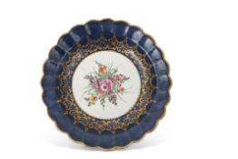 18th century Worcester plate, the gros bleu ground with a gilt design to the centre with floral