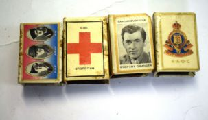 Group of four matchbox holders