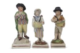 Group of three early 19th century pearlware figures, one of a skater on a rectangular base, two