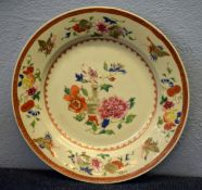 18th century Chinese porcelain plate decorated in famille rose style with a vase and flowers, the