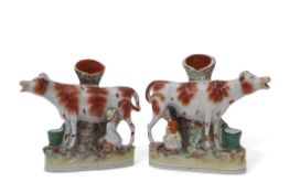 Pair of Staffordshire milking groups, both decorated in typical fashion with milkmaids and the