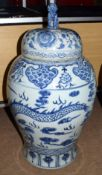 Large pair of Chinese porcelain temple jars and covers with dog of foo finials, the jars decorated