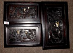 Group of three carved Oriental hardwood panels with ivory inlay featuring immortals, in a wooded