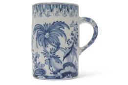Large 18th/19th century Delft ware tankard, with an armorial design to centre bordered by floral