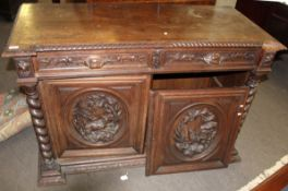 Heavy Gothic oak carved sideboard with two frieze drawers over panelled door carved in the centre