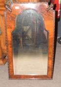 Mahogany wall mirror of arched form with shaped top, the two upper corners carved with acanthus leaf