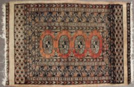 Small 20th century woollen prayer rug in beige and blue with four medallions to the centre, 57cm x