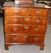 Early 18th century style walnut chest crossbanded top over two short and three full width