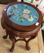 Unusual Eastern Oriental hardwood circular occasional table inset with a floral cloisonne panel