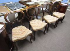 Set of four mid-Victorian mahogany balloon back dining chairs with fleur de lys style carved
