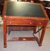 Reproduction mahogany architects table, the adjustable top with central inset and the frieze below