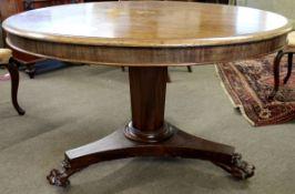 William IV period mahogany circular pedestal breakfast table on triform base with heavy paw feet,
