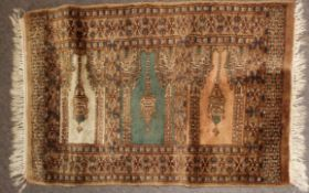 Small 20th century thick woollen prayer rug in beige and blue with three minarets panels to