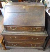 Oak bureau, fall front over a fitted interior with three drawers below, 18th century and later,