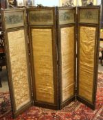 19th century four panel dressing screen, the glazed tops enclosing printed on silk panels with