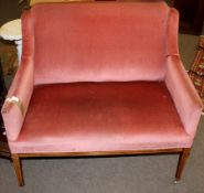 Edwardian part cottage suite comprising a small two-seater sofa and single matching armchair, a