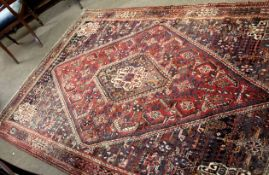 Early/mid-20th century large Caucasian wool rug in mauve, beige and blue with large shaped oval