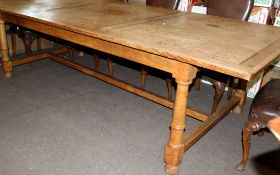 Early 20th century light oak and pine rectangular dining table, the panelled top on a light oak
