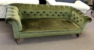 Late 19th century oak framed green button back upholstered Chesterfield, short tapering spade