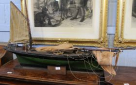 Late 19th/early 20th century painted wooden model of a sailing cargo boat on stand, 113cm wide x
