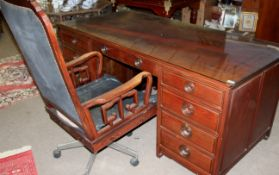 Good quality late 20th century Oriental hardwood twin pedestal desk with plate glass top together