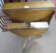 19th century mahogany two-tier dumb waiter with two drop down circular tiers to a turned column