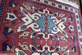 Mid/late 20th century Caucasian wool rug with geometric patterns in pale red, blue and beige,