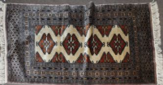 20th century Shiraz wool rug in blue, brown and beige with four large medallions to the centre, 77cm