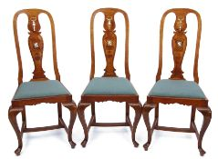 Set of six early 20th century walnut dining chairs, the arched tops with vase shaped splat backs,