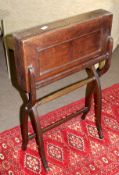 Late 19th century oak campaign desk, folding top with worn and fitted interior raised on a folding