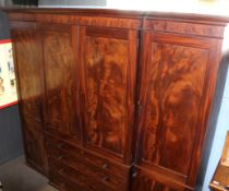 Large Regency period mahogany break front wardrobe moulded corners over central panelled doors