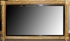 19th century gilt and gesso rectangular overmantel mirror, the Torus moulded surround decorated with