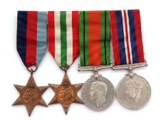 WWII group of four comprising 39-45 Star and Italy Star, together with Defence Medal and War Medals,