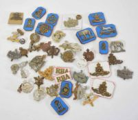 Mixed quantity of military cap badges, varying dates and crowns to include Royal Armoured Corps,